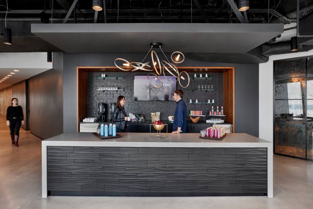 Coffee shop bar with drinks on counter.