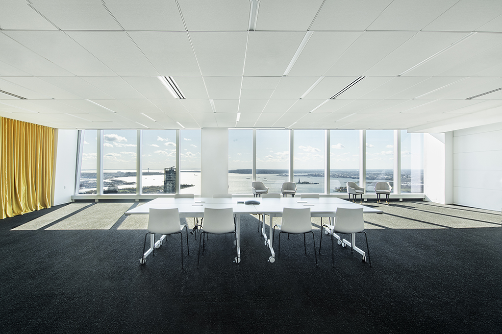 Conference room with river views containing a table and eight chairs.