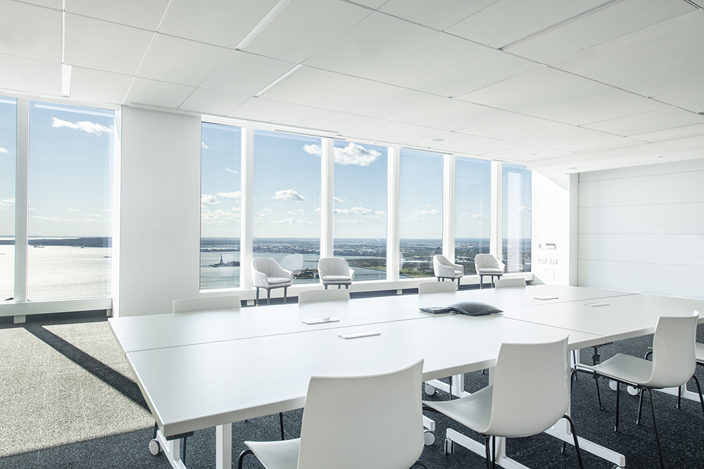 Meeting space with river views and a large conference table and six chairs.