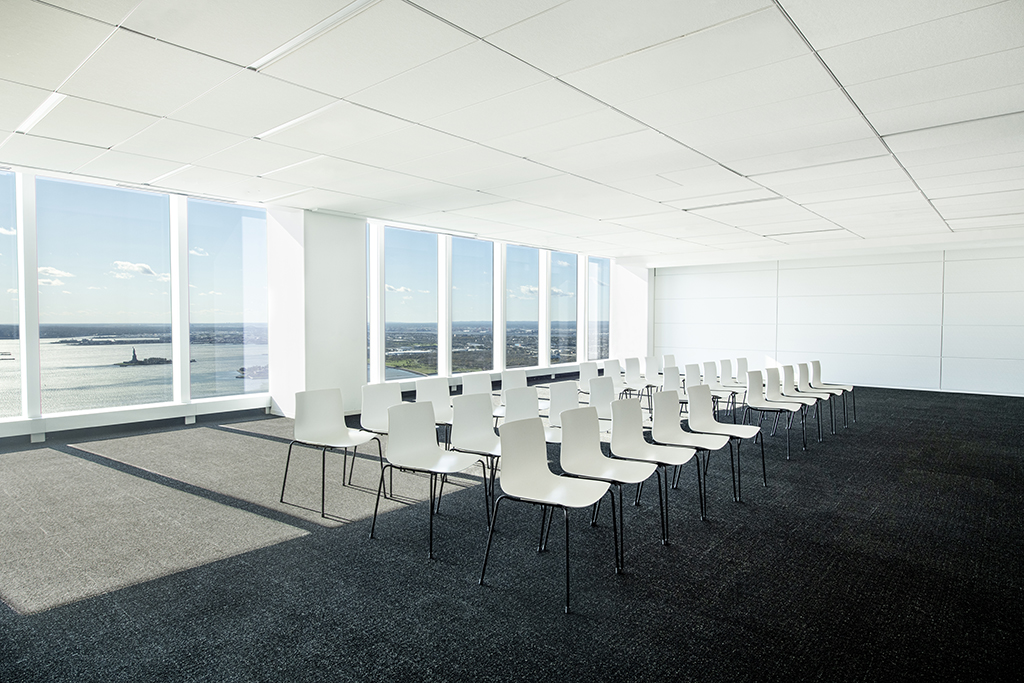 Meeting space with river views and 30 chairs arranged in three rows of 10 chairs per row.